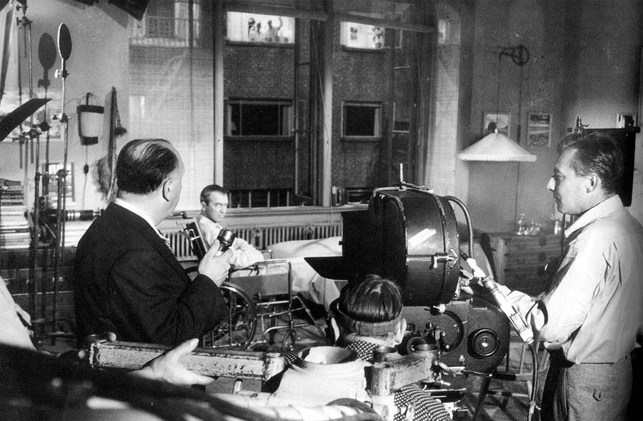 Alfred hitchcock looks in on rear window
